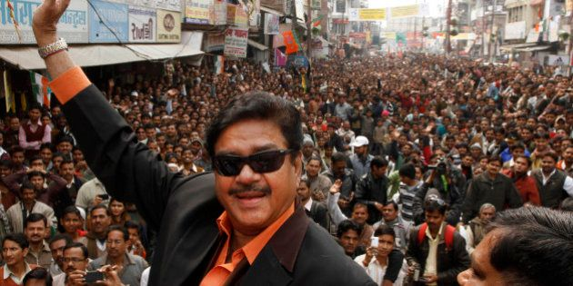 Bharatiya Janata Party leader and Bollywood actor Shatrughan Sinha, waves to the crowd as he attends...