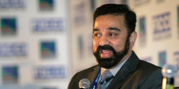 Indian Tamil film actor Kamal Haasan gestures as he speaks during a session at the Federation of Indian...