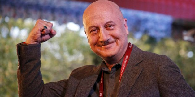Bollywood actor Anupam Kher gestures to the audience during a session at the Jaipur Literature Festival...