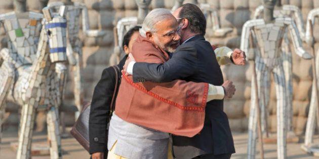 Indian Prime Minister Narendra Modi, left and French President Francois Hollande greet each other at...