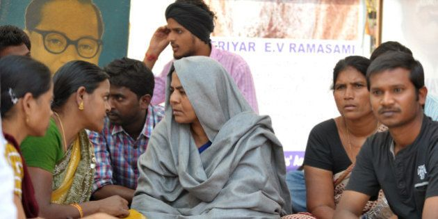 Radhika Vemula, the mother of a student who committed suicide on January 17, sits during a protest at...