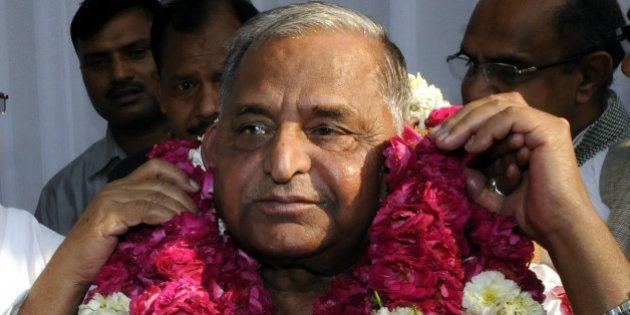 NEW DELHI, INDIA - APRIL 15: Samajwadi Party chief Mulayam Singh being garlanded after merger of six...