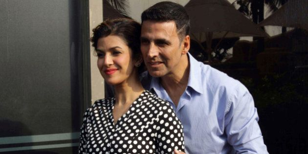 Indian Bollywood actors Akshay Kumar (R) and Nimrat Kaur pose during the media interaction of their upcoming...