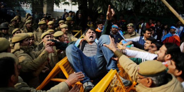 A member of the National Students Union of India (NSUI), the student wing of India's main opposition Congress party, shouts slogans as he got entangled in police barricade during a protest against the death of Rohith Vemula in New Delhi, India, Friday, Jan. 22, 2016. The students were protesting the death of Vemula who, along with four others, was barred from using some facilities at his university in the southern tech-hub of Hyderabad. The protesters accused Hyderabad University's vice chancellor and a federal minister of unfairly demanding punishment for the five lower-caste students after they clashed last year with a group of students supporting the governing Hindu nationalist party. (AP Photo/Altaf Qadri)