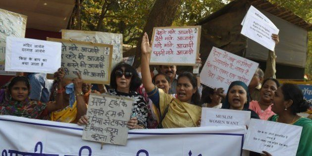 Indian activists take part in a protest against a ban on women entering its inner sanctum of the Haji...