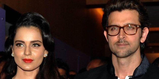 Indian Bollywood actors Hrithik Roshan (R) and Vivek Oberoi (L) pose with actress Kangana Ranaut (C)...