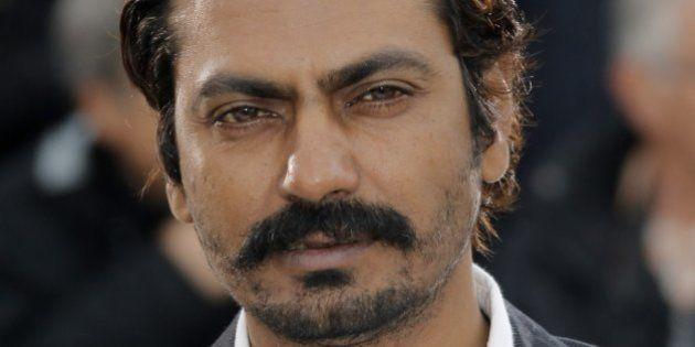 Actor Nawazuddin Siddiqui poses for photographers during a photo call for the film Monsoon Shootout at...