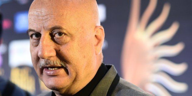 Bollywood actor Anupam Kher speaks to the media on the green carpet at the Tampa Convention Center ahead...