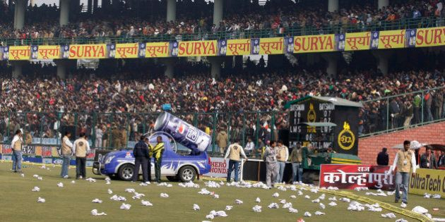 Rolled seat covers are seen lying on the ground after spectators threw them in protest after the fifth...