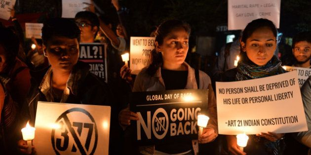 Indian LGBT activists hold placards as they demonstrate against the Supreme Court's reinstatement of...