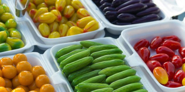 Plates of vegetables for sale in