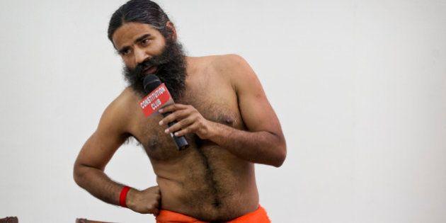 """Indian yoga guru Baba Ramdev speaks to the media an Ayurvedic medicine called """"Putrajeevak Beej"""",..."""