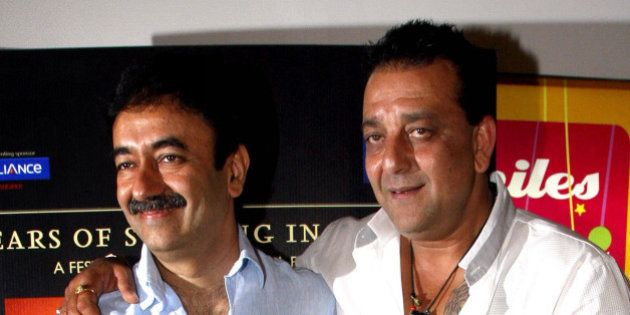 Indian Bollywood film actor and cast member of Hindi film 'Lage Raho Munna Bhai', Sanjay Dutt (R) and...
