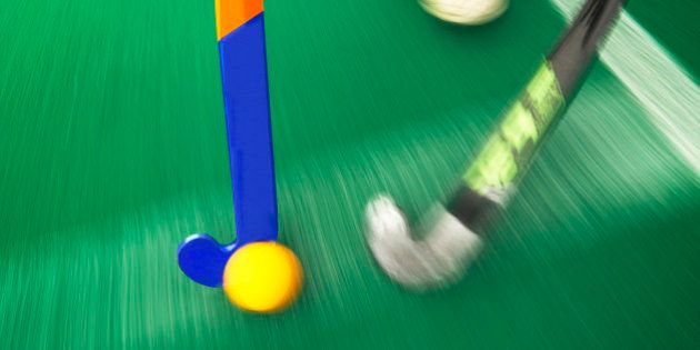 Hockey tackle with a yellow ball
