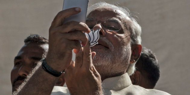 AHMEDABAD, INDIA - APRIL 30: BJP leader Narendra Modi takes a picture of himslef, his inked finger and...