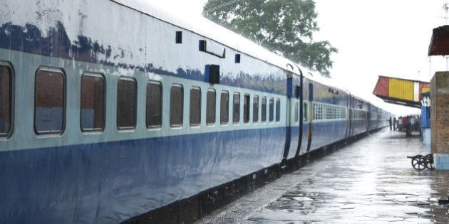 blue color coaches of indian train stainding in a station during