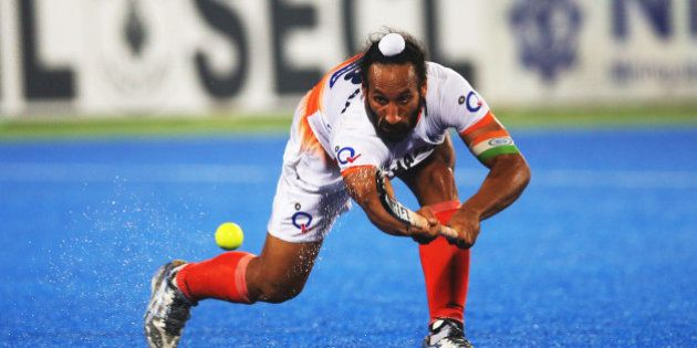 RAIPUR, INDIA - DECEMBER 05: Sardar Singh captain of India passes the ball during the match between India...