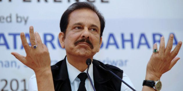 Chairman of India's Sahara Group Subrata Roy gestures as he addresses a press conference in Kolkata on...