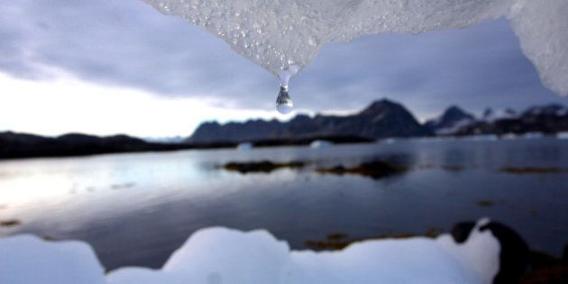 An iceberg melts in Kulusuk, Greenland near the arctic circle Tuesday Aug, 16, 2005. Scientists say that...