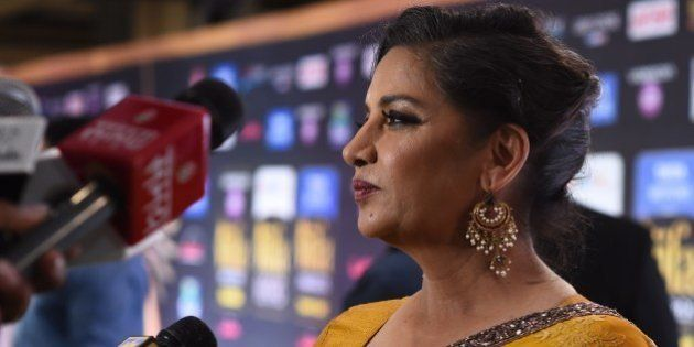 Indian actress Shabana Azmi poses on the green carpet at the Tampa Convention Center ahead of IIFA Rocks...
