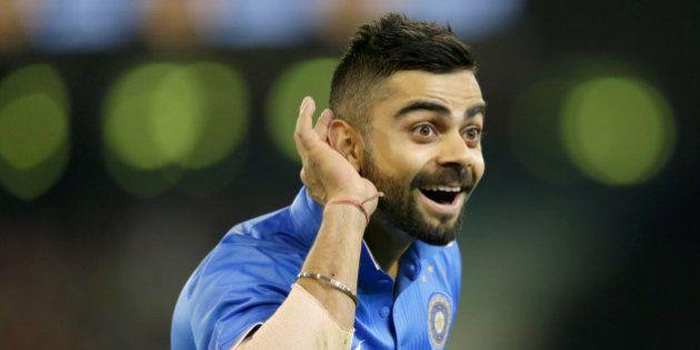 MELBOURNE, AUSTRALIA - JANUARY 29: Virat Kohli of India gestures to Australian fans after India took...
