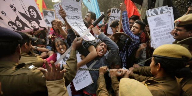 Policemen try to stop Indian students as they march towards the office of Hindu nationalist Rashtriya...