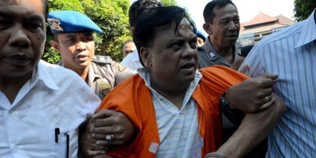 Indian national Rajendra Sadashiv Nikalje, 55, known in India as Chhota Rajan, is brought out from a...