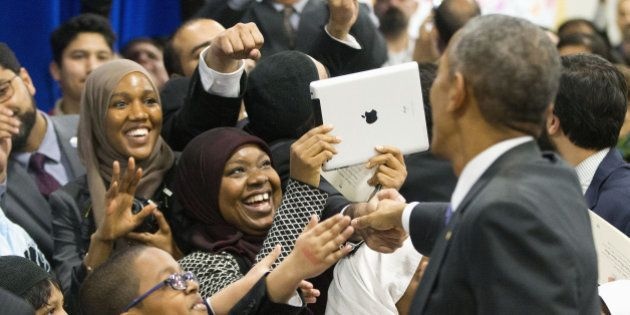 President Barack Obama greets children from Al-Rahmah school and other guests during his visit to the...