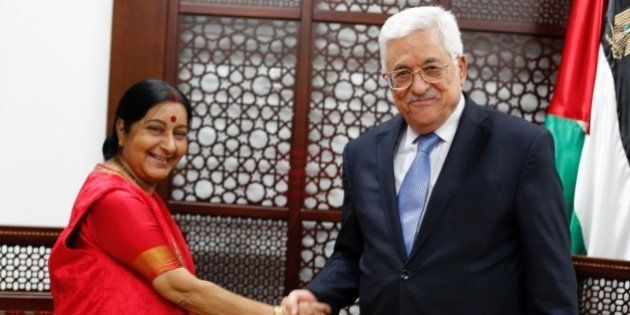 Indian Foreign Minister Sushma Swaraj meets with Palestinian President Mahmud Abbas (R) on January 17,...