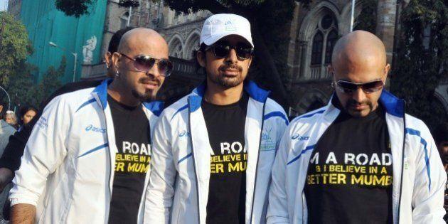 Indian Bollywood celebrity MTV Roadies pose during the Standard Chartered Mumbai Marathon (SCMM) 2012...