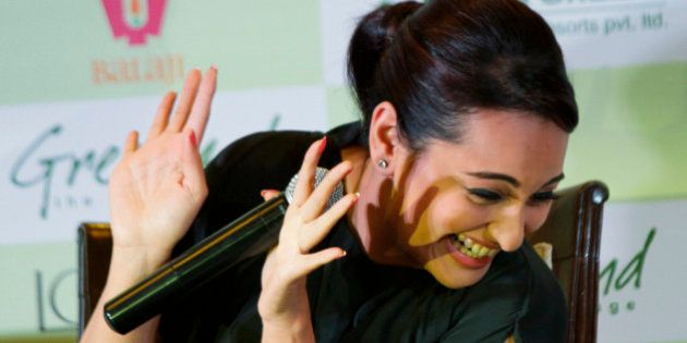 Bollywood actress Sonakshi Sinha gestures during a promotional event of her forthcoming