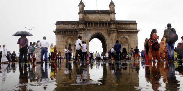MUMBAI, INDIA - JULY 29: People enjoy after heavy rain at Gateway of India on July 29, 2015 in Mumbai,...