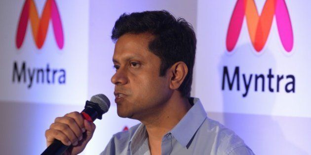 CEO of Myntra and Head of Commerce, Flipkart, Mukesh Bansal addresses the media during a press conference...