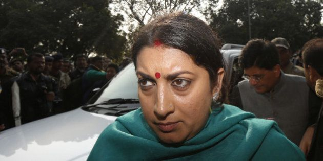 NEW DELHI, INDIA - DECEMBER 21: HRD Minister Smriti Irani comes out of the Patiala Court on December...