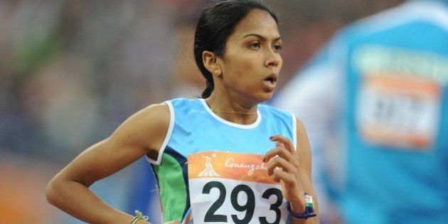Kavita Raut of India compete in the women's 5,000m final in the athletics competition at the 16th Asian...