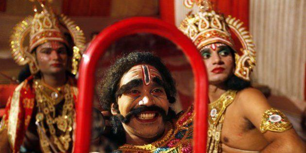 NEW DELHI, INDIA - SEPTEMBER 27: Local actor dressed as the Hindu demon king Ravan as he prepares backstage...
