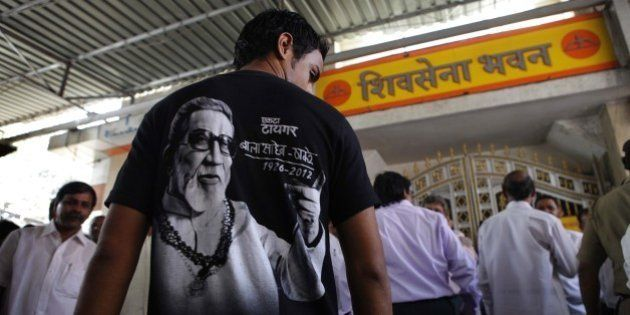 MUMBAI, INDIA - JANUARY 23: A Shiv Sena supporter flaunts a picture of Shiv Sena Supremo, Late Bal Thackeray...