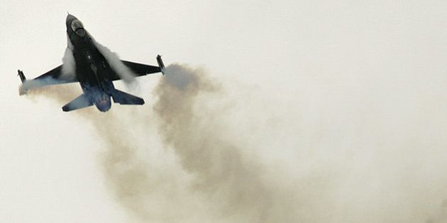 A US Air Force General Dynamic-made F16 jet fighter performs its demonstration flight, at Le Bourget,...