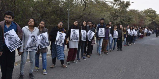 NEW DELHI, INDIA - FEBRUARY 14: JNU teachers and students form a human chain inside the campus in protest against arrest of JNU Student's Union president Kanhaiya Kumar, demand the release of Kanhaiya Kumar who was arrested on sedition charge in connection with an event organised on the campus against the hanging of Afzal Guru, at JNU campus, on February 14, 2016 in New Delhi, India.  Jawaharlal Nehru University (JNU) teachers association said that they have never supported any unconstitutional activity inside the campus and have always opposed it. Kanhaiya Kumar was arrested in connection with a case of sedition, seven more students from the university have been detained after a controversial event to protest the hanging of 2001 Parliament attack convict Afzal Guru three years ago. The protesters also allegedly shouted anti-India slogans during the event. (Photo by Sanjeev Verma/Hindustan Times via Getty Images)