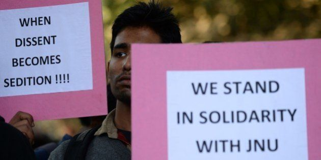 Indian students hold placards during a protest aganist the arrest of the president of Jawaharlal Nehru...