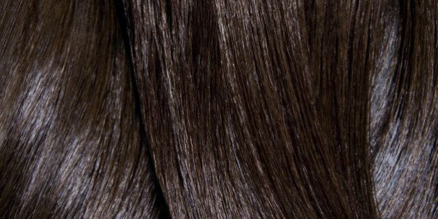 Tight crop of shiny dark brown