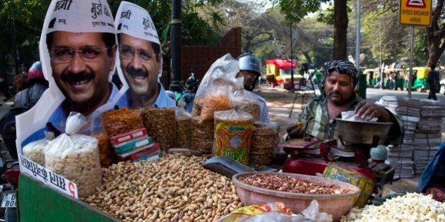 Cut out photographs of Aam Aadmi Party, or Common Man Party, leader Arvind Kejriwal, adorns the cart...