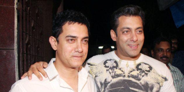 MUMBAI, INDIA � SEPTEMBER 6: Aamir Khan and Salman Khan at the special preview of the film 'Dabaang'...