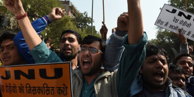 Indian right-wing activists shout slogans during a protest outside Jawaharlal Nehru University (JNU)...