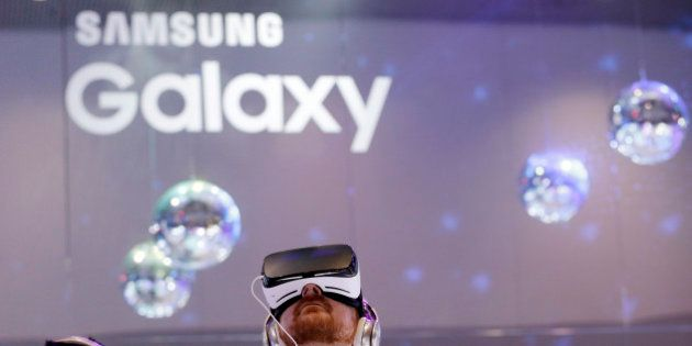 People wear Samsung Gear VR sets during a virtual reality demonstration at CES International Wednesday,...