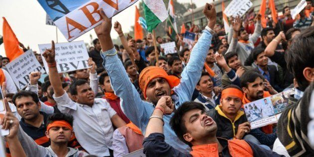 Indian demonstrators shout slogans during a rally against the Jawaharlal Nehru University Students Union...