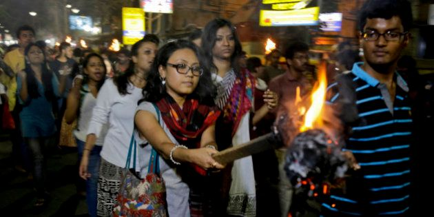 Students of Jadavpur University march in a torch light procession protesting against the arrest of a...