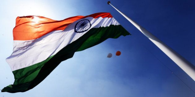 NEW DELHI, INDIA - MARCH 7: The largest National Flag measuring 60 ft X 90ft flutters atop 207 ft tall...