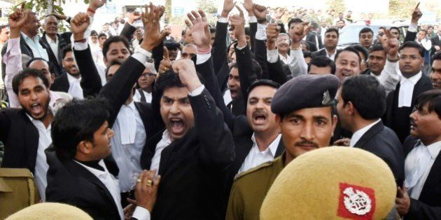 NEW DELHI, INDIA - FEBRUARY 15: A group of lawyers allegedly thrashed protesters and journalists inside...