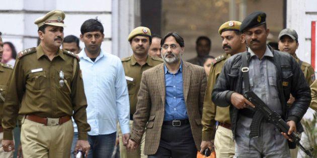 NEW DELHI, INDIA - FEBRUARY 16: Delhi Police officers arrest SAR Geelani (Syed Abdul Rahman Geelani),...